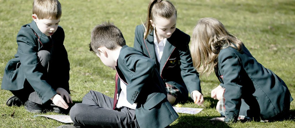 children learning in the sun