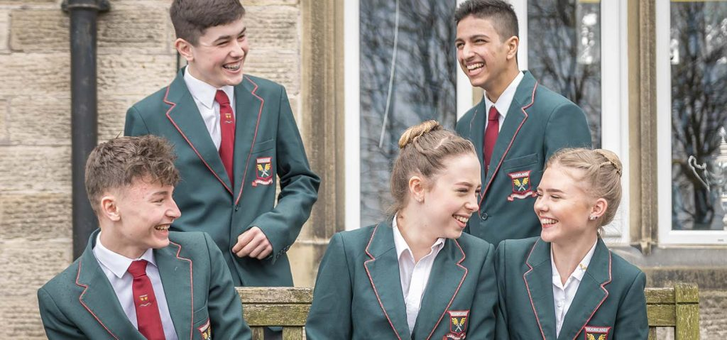 Students in Blazers laughing