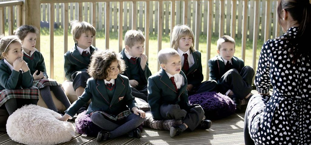 young students learning outside