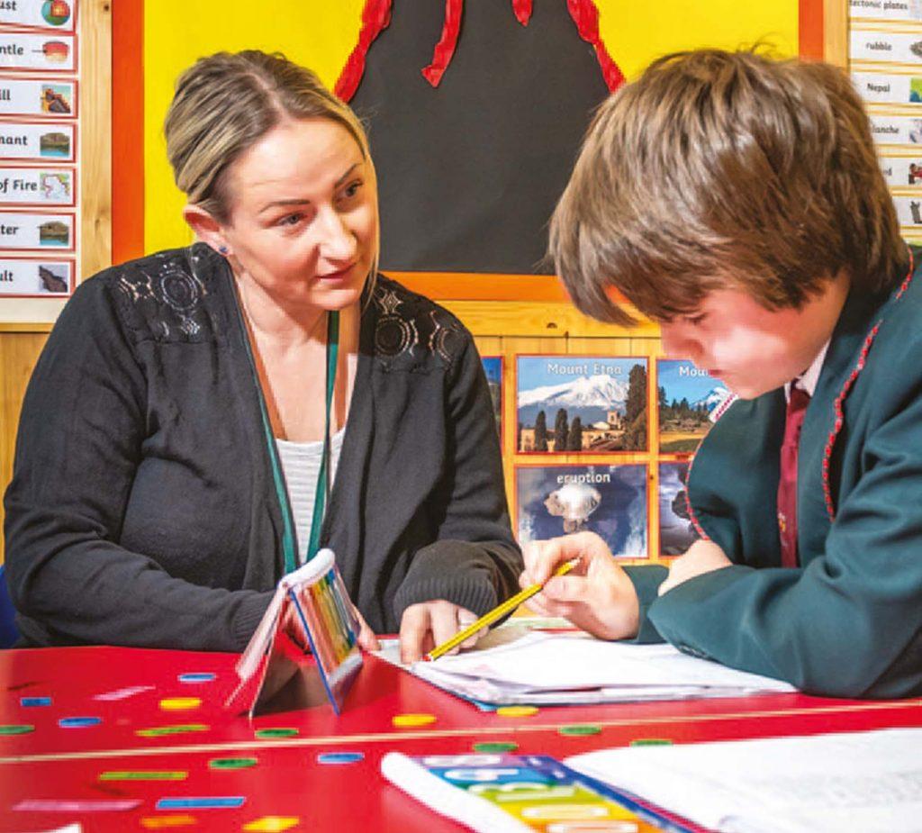 teacher instructing boy