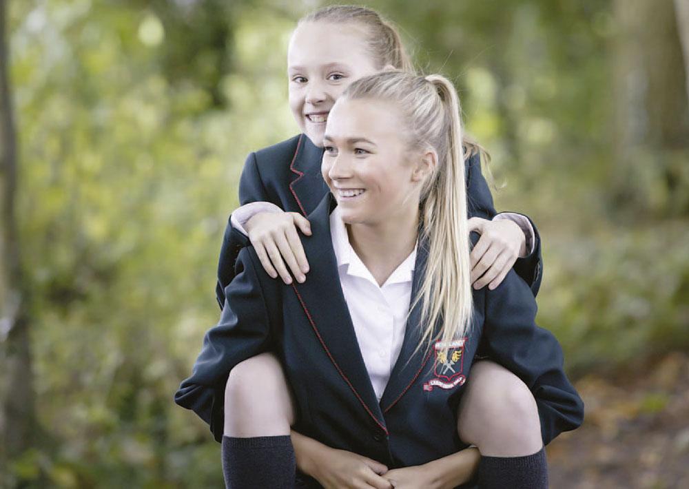 girls giving piggyback ride