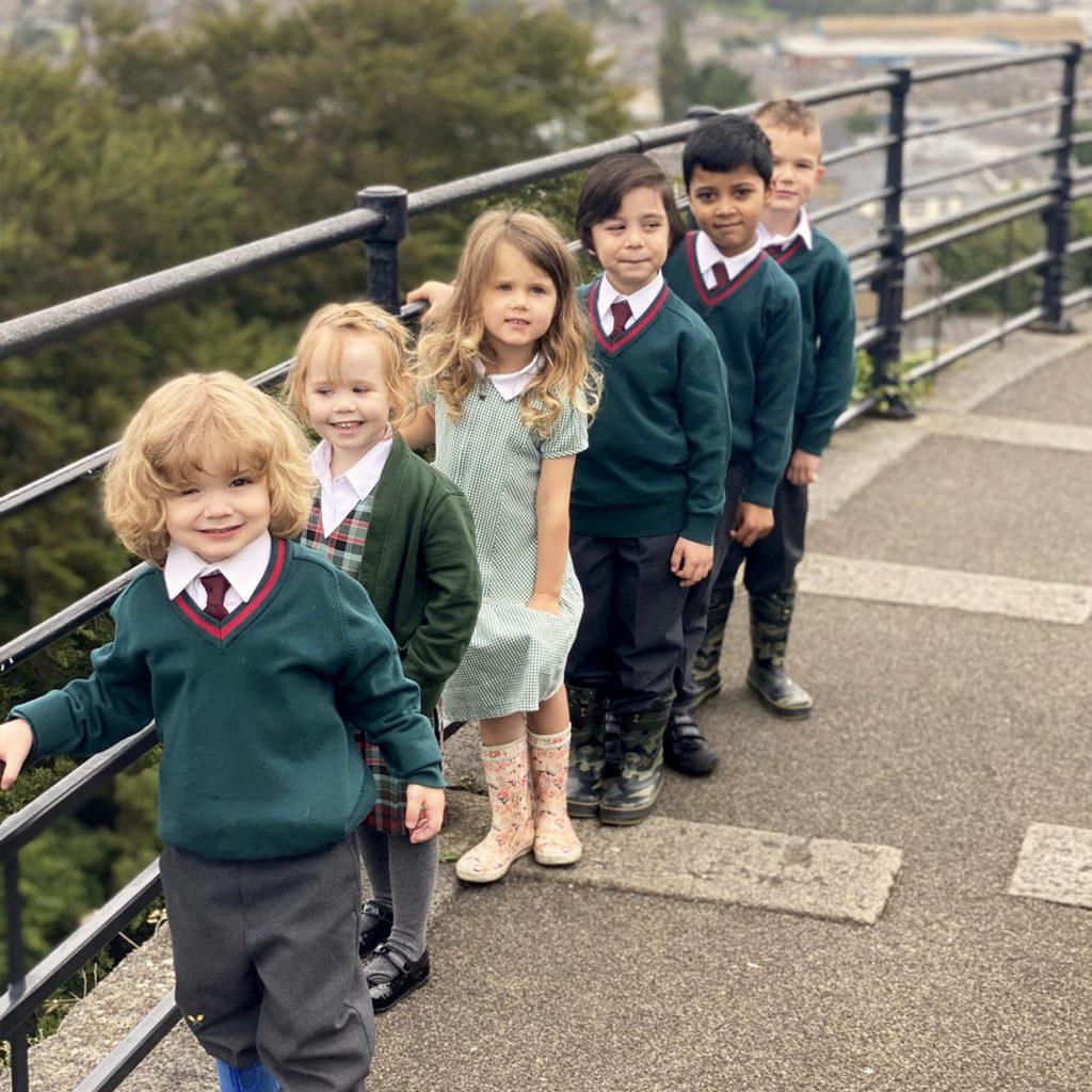 children holding rail