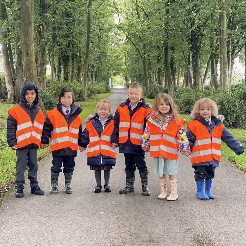 students in reflective jackets