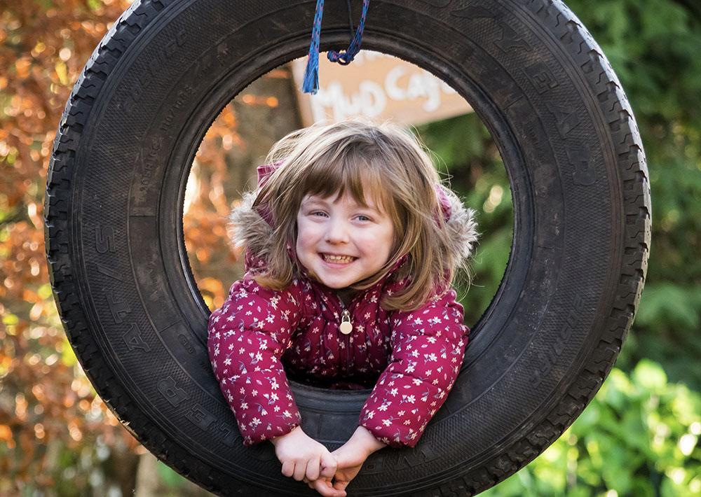 girl in tire swing