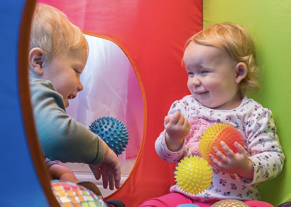 babies laughing at each other