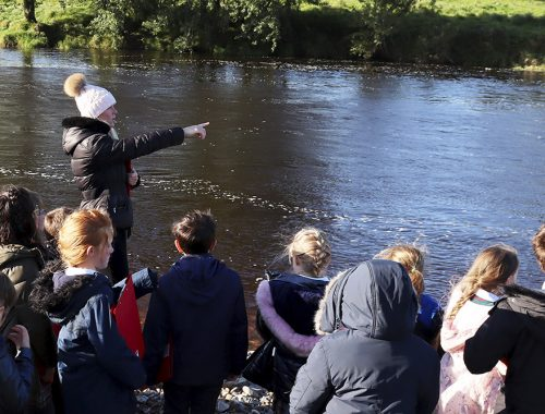 teaching pointing at river