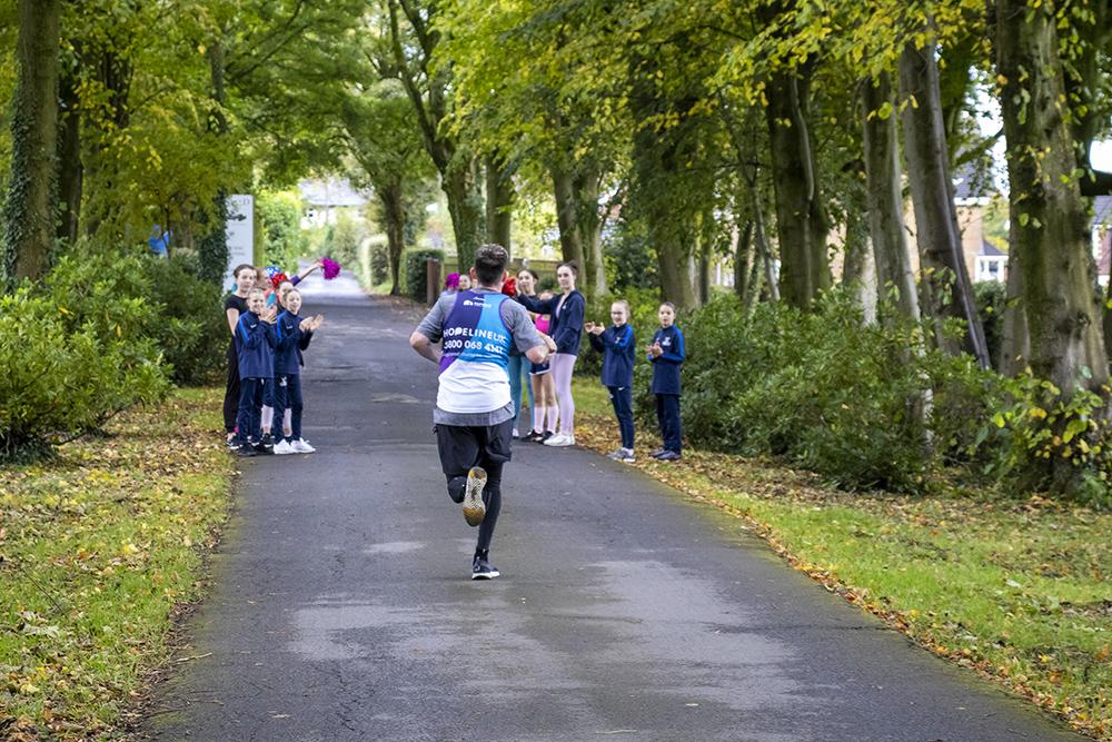man reaching finish line