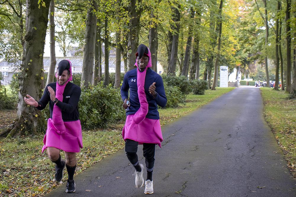 men running in flamingo suits