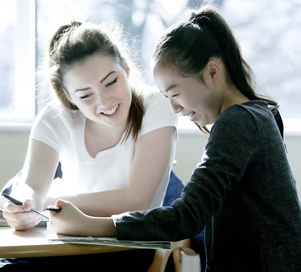 teacher and student laughing