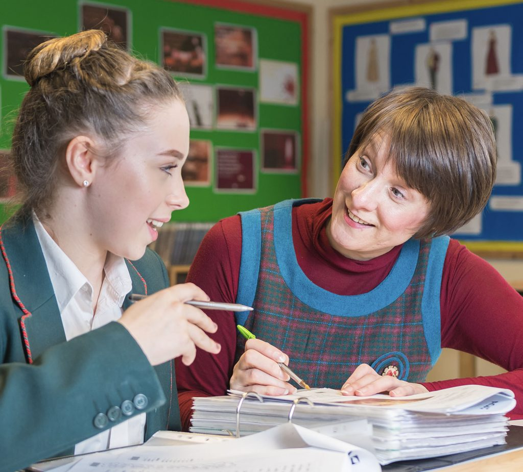 teacher smiling at student