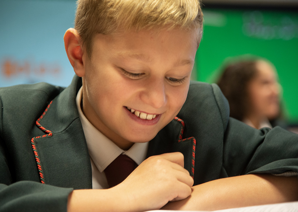 boy smiling in blazer