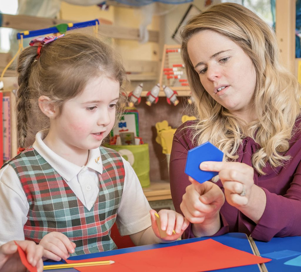teacher teaching shapes