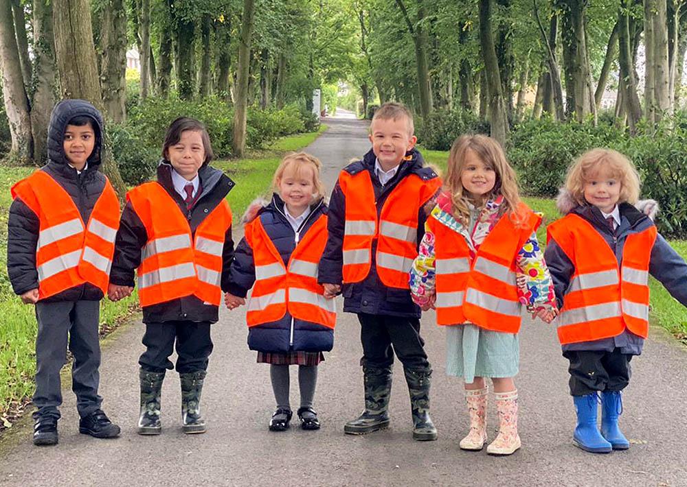 children in reflective jackets